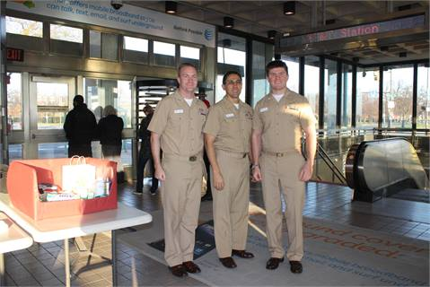 (From left) Lt. Vaughn Cooper, Lt. Commander Sal Torres and Lt. Joe Bossi collected donations and signed cards from passengers at SEPTA's AT&T Broad Street Line Station.