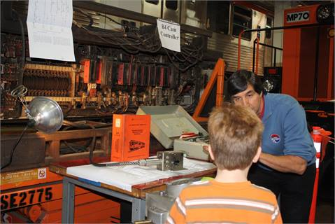 A SEPTA employee explains the operation of the Authority's Broad Street Line subway to a young Rail Rodeo attendee.