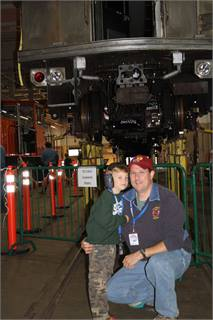 Rail fans Liam and Bill McCann get an up-close view of a Broad Street Line car.