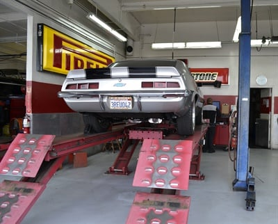 Alignment racks, like this one at Redwood General Tire Pros, can last decades, but the technology component needs constant updating.