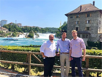 Paul Comfort (left) standing with Alexander Schulze (middle), AMoTech Project Manager, and Yannick Buzberger (right), Trapeze Marketing Specialist at the Rhine Falls where the second Trapizio AV will soon be transporting passengers.