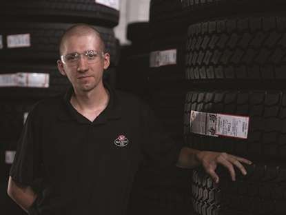 Andy Kopko is one of McCarthy Tire Service's success stories. He's risen from retread shop janitor to plant manager. He knows first hand working in a retread plant is difficult, physical work, but it can also be rewarding and provide a good living. (Photo by Michael Touey, Halibut Blue LLC)