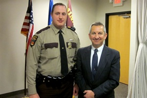 Lt. Brian Reu (left) was appointed the director of the Minnesota Office of Pupil Transportation Safety after the retirement of Lt. Ed Carroll (right).