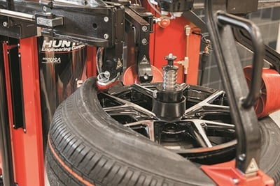 Hunter Engineering's Revolution tire changer features a center-clamp style and polymer mount head for servicing challenging assemblies, including raised spoke and dark finish wheels.