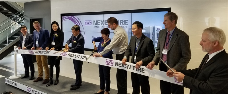 The ceremonial ribbon cutting for the new Nexen Tire America Technology Center was done by (from left):  Jong Sun Kim, Nexen Tire America president; Joe Welch, head of brakes, wheels and tires purchasing for Fiat Chrysler Automobiles; Wonsun Jung, wife of Travis Kang; Travis Kang, Nexen vice chairman and global CEO; Bobbie Beshara, mayor of Richfield; Dan Wysocki, systems and component chassis engineering, manager - design responsible for tires for Fiat Chrysler Automobiles; Don Lee, head of Nexen Tire America Technology Center, Gary Zolton, Nexen project engineer (retired); and Dean Rogers, section manager tire technology for Nexen.