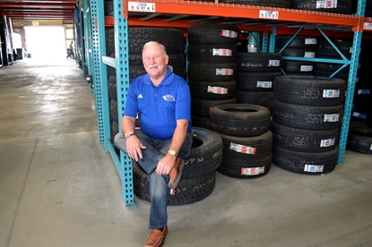 Ricky Benton posed for a photo in the Black's Tire Service Whiteville, N.C., warehouse in 2015. The company will spend more than $2.6 million to nearly double the size of the warehouse, its largest.