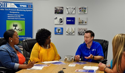 Brian Rigney shares his perspective with, from left to right, Phyllis Newman, Allison Stephens and Emily Woodard, Dill customer service representatives.