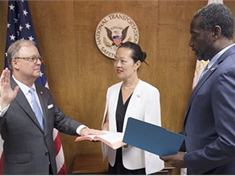 Robert L. Sumwalt III (left) was sworn in as the National Transportation Safety Board's 14th Chairman during a brief ceremony held at NTSB headquarters. NTSB Board Member Bella T. Dinh-Zarr (center) NTSB Acting Managing Director Dennis Jones (right) (Photo by NTSB).