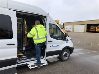 Shown here is the wheelchair lift activated rearward using the Shift N Step system so ambulatory passengers can access the van. Photo courtesy Rochester Public Schools