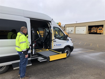 Rochester (Minn.) Public Schools has equipped one of its transit vans with the AbiliTrax Shift N Step, a dual-entry system to provide transportation service to ambulatory students and those who use wheelchairs. Photo courtesy Rochester Public Schools