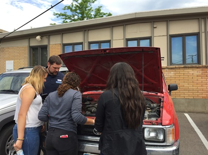 Nate Hockman, on the left, volunteered to help owner John Roemer during the business' car care clinic. The event was part of a month-long campaign to support the local YWCA.