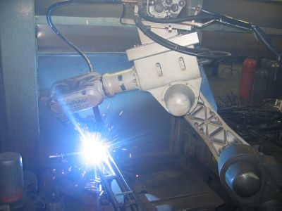 In 2005, Rosco opened a new expanded plant (robotic welding is seen here). Englander, 82 at the time, bought a mobility cart so he could get around the shop floor — his favorite area of the company.
