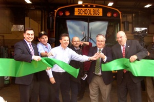 Superintendent James Wigo (right), school board President John Hanna (second from right) and other dignitaries took part in a ribbon-cutting ceremony for Rose Tree Media School District's new CNG buses.
