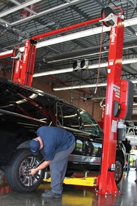 Lifting pads and extensions allow for safe, snug contact with the vehicle axle surface. They help prevent slippage and are a must for servicing body-on-frame vehicles. Photo courtesy of Rotary Lift.