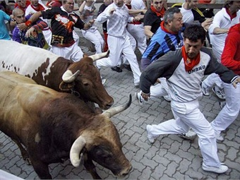 Running of the bulls in Pamplona, Spain.