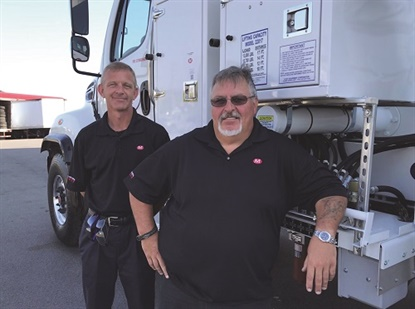 Russ Devens, left, and Mark Shimko are two of McCarthy Tire Service's safety experts. Devens leads safety efforts companywide and this year coordinated a national safety summit for employees from 14 commercial tire dealerships in the U.S. Shimko is one of two McCarthy OTR truck operators who has left his own truck behind to dedicate all his time to training the company's OTR tire personnel. (Photo courtesy McCarthy Tire Service)