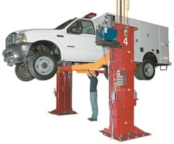 If the shop plans to service heavy-duty trucks, consider the load rating capabilities, as your current lifts may not be able to handle the added weight. Shown here is an example of a twin-post lift rated at up to 30,000 lbs.