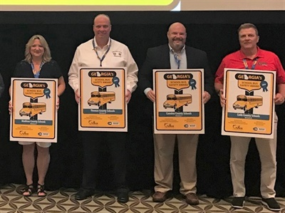 Georgia's Department of Education honored 16 of the state's school districts at its second annual Pupil Transportation Safety Awards during the Georgia Association for Pupil Transportation conference on June 17. Shown here are the Division 5-8 Blue Award winners. Photo by John Osborne, Georgia DOE