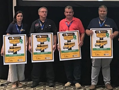 The winning districts were split into a total of eight divisions based on enrollment size, and then were evaluated on a number of factors that impact school bus safety. Shown here are the Division 1-4 Green Award winners. Photo by John Osborne, Georgia DOE