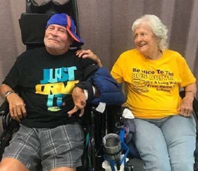 Kenny Neff (left) and Eileen Thompson were both gifted t-shirts similar to those that the transportation department wears every Wednesday. Thompson is a former school bus driver herself. Photo courtesy Kim Williamson