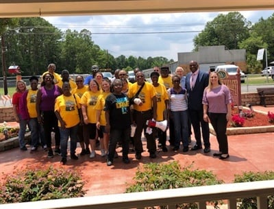 More than 20 of Hamilton County (Fla.) School District's transportation staff visited Suwannee Valley Nursing Center on June 5 to interact with residents who waved at them all school year. Photo courtesy Kim Williamson