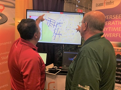 Antonio Civitella, president and CEO of Transfinder (left), and Richard Gallagher, director of transportation for Bay Shore (N.Y.) Schools, discuss Transfinder's Routefinder PLUS at the 2018 New York Association for Pupil Transportation conference.