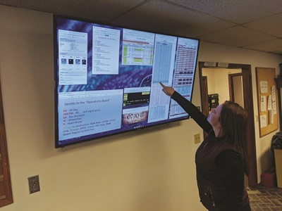 The transportation department's operations board is a series of Google Sheets with data covering routes, driver, and district information managed by dispatch and displayed on a 64-inch monitor. Photo courtesy Central Valley School District
