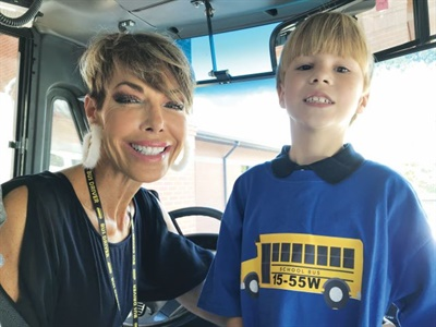 "Pollard spearheaded a ""special"" school bus ride for Wyatt, who is shown here with bus driver Grace Tyler. Photo courtesy Baldwin County (Ala.) Public Schools"