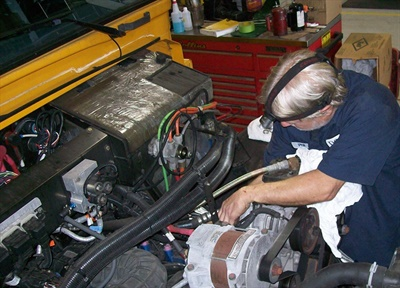 One of the key distinctions between diesel and propane school buses is that spark ignition systems in propane engines require spark plugs to be changed every 50,000 miles. Photo courtesy Pinellas (Fla.) County Schools
