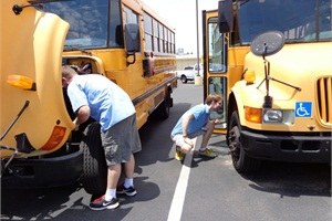 "Here, Mesa (Ariz.) Public Schools substitute drivers pre-trip buses in preparation for a run. Director of Transportation and Vehicle Maintenance Ron Latko says subs are ""life savers"" to a transportation operation because they are flexible in what they do."
