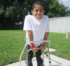 "Osteogenesis imperfecta (OI) is a genetic disorder that is commonly called ""brittle bone disease."" Fernando, a student with Type III OI, prefers his walker slightly shorter than his therapist does."