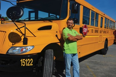 Because Birnie Bus shares similar goals, values, and a dedication to providing safe, high-quality service, it was an ideal acquisition for Krapf. Shown here is Rafik Avdic, who has been a school bus driver at Birnie Bus since 2002.