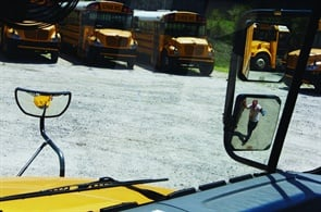 This photo shows the right convex mirror adjusted to enable the driver to see the bus' entrance door area. Derrill Browning of Mirror Lite Co. says having a good view of this area can help to prevent accidents involving students.