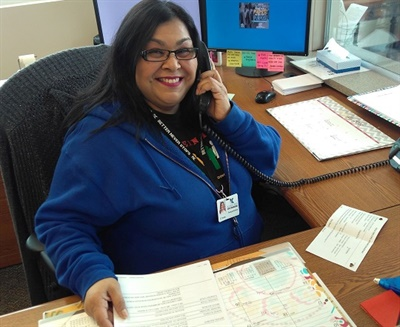 Drivers for Klein (Tex.) Independent School District get extra pay for pulling video footage and answering phones and translating conversations during the lunch hour, as lead driver Cynthia Torres is shown doing here. Photo courtesy Steven Ilten
