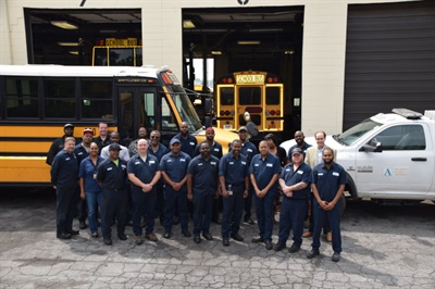Franklin (back row, far right) spearheaded an overhaul of the fleet maintenance team, creating new leadership positions and technician positions with stronger skill sets and higher salaries.
