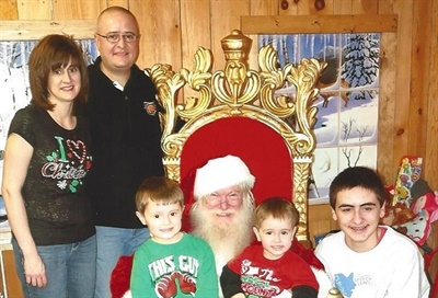Jeff Vrabel Sr., his wife Mary, and his sons Kenneth, Phillip, and Jeff Jr. pay a visit to Santa Claus.