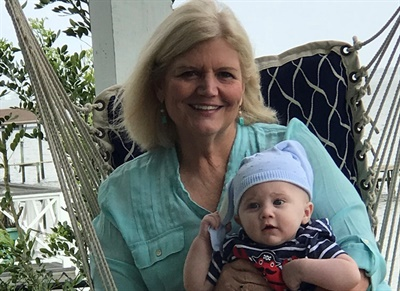 Spending time with family is at the top of Marisa Weisinger's list of interests outside of work. She is seen here with grandson Colt.