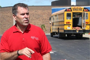 A Gray Ram Tactical instructor teaches a class using a school bus.