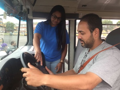 Connecticut-based bus company DATTCO is using an online assessment from JOBehaviors as part of its driver hiring process. Here, a driver trainer works with a new hire.