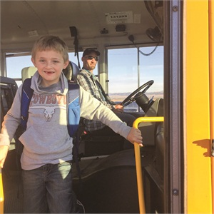 Thomas Cohn, transportation manager at Helena (Mont.) Public Schools, doesn't see seat belts as a hindrance to a quick exit — one of the key concerns about adding them to school buses. Helena's student riders practice unbuckling not just during twice-yearly evacuation drills, but every time they get off of the bus. Cohn's 8-year-old son Kaden is one of those riders.