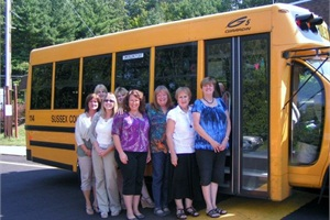 Amanda Ferrington (front row, second from left), coordinator for the Sussex County Regional Transportation Cooperative in Hopatcong, N.J., says the cooperative saved several of its member districts almost $1.3 million last year by restructuring and re-bidding their routes.