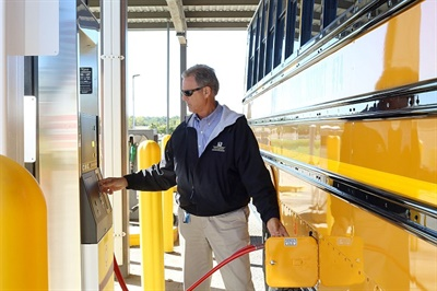 David Curry, lead trainer at North Kansas City Schools, refuels one of the district's 124 new CNG buses.