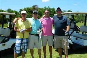 Jim Beekman (left) doesn't get to play golf often, but when he does, he enjoys playing with his three sons.