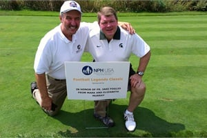Kellie Dean (right) is pictured here with orphanage founder and friend John Shinsky at an NFL Hall of Fame golf event for the Shinsky Orphanage.