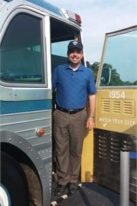 """Joshua Hinerman describes himself as a """"bus nut."""" He's pictured here at a Greyhound event."""