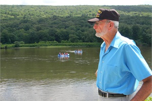 World War II veteran Earl Rineer, pictured here by the Delaware River, has been training school bus drivers since 1977.