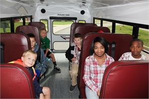 "Monark Student Transportation Corp.'s fleet includes about 90 school bus constructed vehicles (pictured), which President Mark D. Schmitt calls ""a safer way [than vans] to transport children in those smaller capacities."""