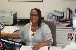 """Nicole Portee says she is glad to play for """"team DPS"""" and is proud of her efforts to brand the transportation department, implement a shuttle system and roll out a districtwide bus pass system."""