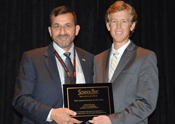 Karam receives the Administrator of the Year award from SBF Executive Editor Thomas McMahon.