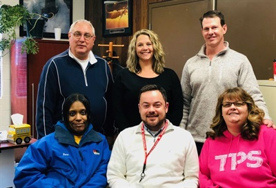Toledo Public Schools transportation team members, shown here, worked together to identify and organize actionable data using a five-step process. Brad Aemisegger, director of transportation, is pictured far left in the top row.